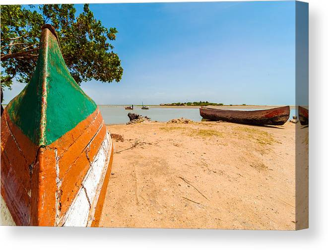 Water Canvas Print featuring the photograph Canoes On A Lakeshore by Jess Kraft