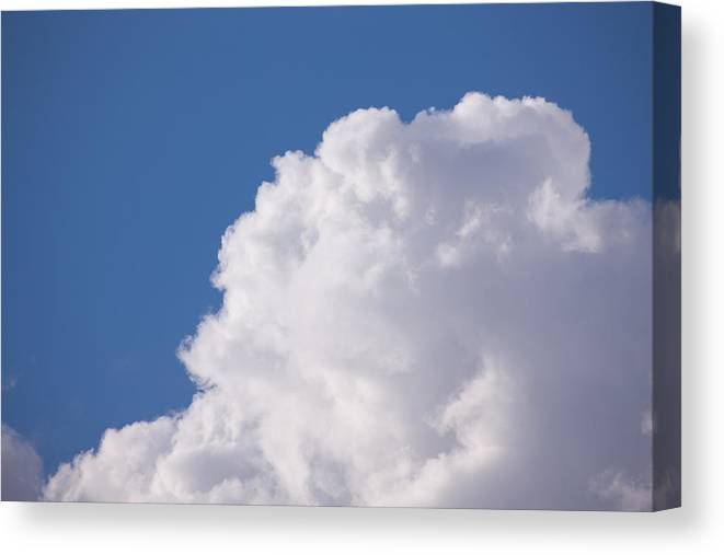 Cumulus Congestus Canvas Print featuring the photograph Clouds by Bernard Lynch