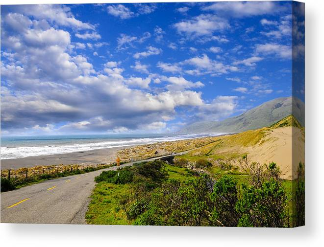 Clouds Canvas Print featuring the photograph Coastal Road by Don and Bonnie Fink