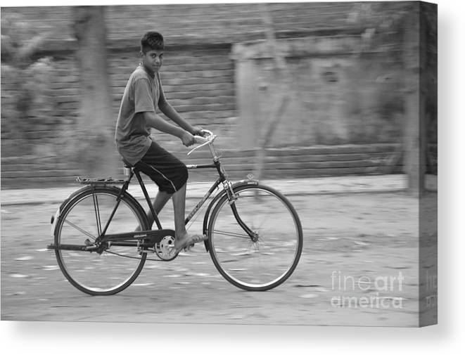 Photograph Canvas Print featuring the photograph Cycling Boy by Ocean Thakur