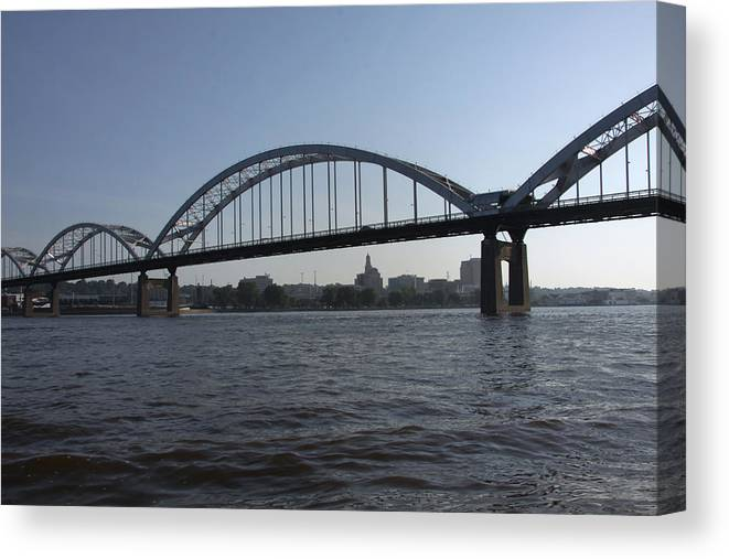 Mississippi River Canvas Print featuring the photograph Davenport Skyline And Centennial Bridge by Heidi Brandt