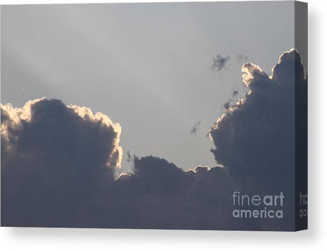 Sky Canvas Print featuring the photograph Evening Clouds by Natalya Streufert