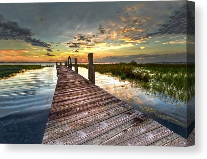 Clouds Canvas Print featuring the photograph Evening Dock by Debra and Dave Vanderlaan
