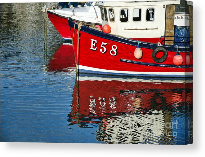 Lyme Regis Canvas Print featuring the photograph Harbour Reds by Susie Peek