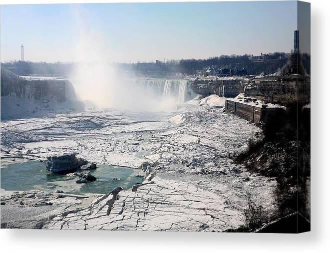 Niagara Falls Canvas Print featuring the photograph Ice Flows At Niagara by Eric Swan