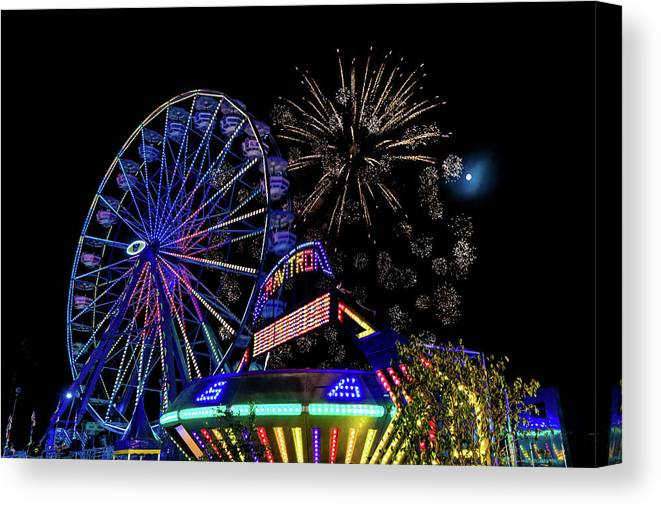 Photography Canvas Print featuring the photograph Illuminated Ferris Wheel With Neon by Panoramic Images