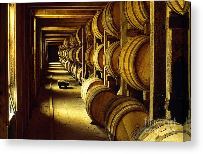 Jack Canvas Print featuring the photograph Jack Daniel Whiskey Maturing In Barrels In Old Warehouse At The Lynchburg Distillery Tennessee Usa by David Lyons