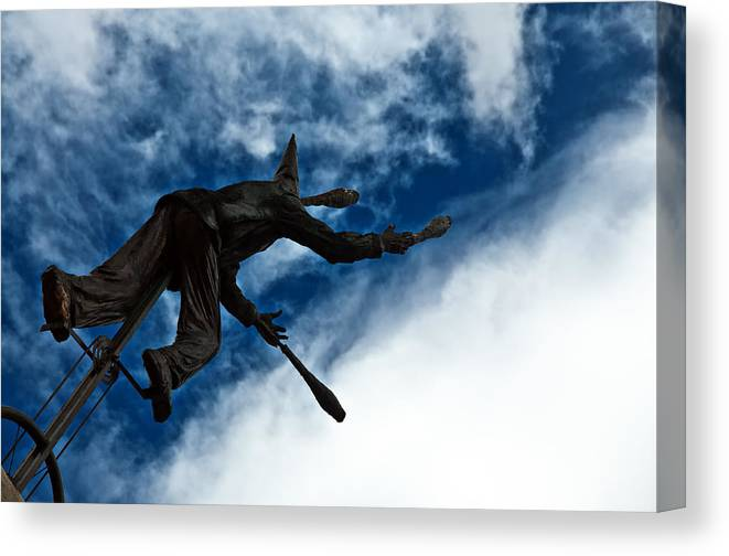 Blue Canvas Print featuring the photograph Juggling Statue by Jess Kraft