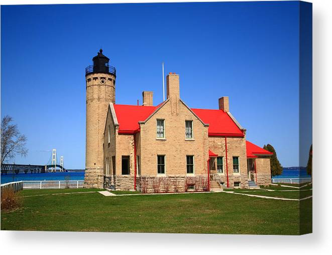 Art Canvas Print featuring the photograph Lighthouse And Mackinac Bridge by Frank Romeo
