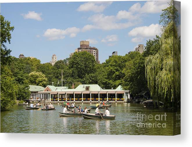 New York City Central Park Parks Tree Trees Buildings City Cities Architecture Lake Lakes Water Boat Boats Loeb Boathouse Boathouses People Person Persons Men Women Waterscape Waterscapes Creature Creatures Canvas Print featuring the photograph Loeb Boathouse by Bob Phillips
