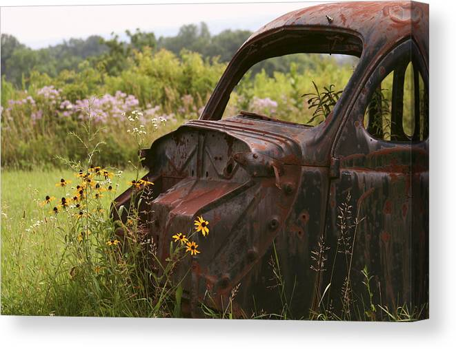 Landscape Canvas Print featuring the photograph Lonely Car On The Prairie by Binsar Marseto