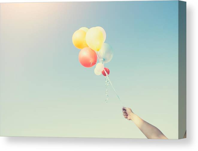 Low Angle View Of Balloons Flying Against Sky Canvas Print Canvas