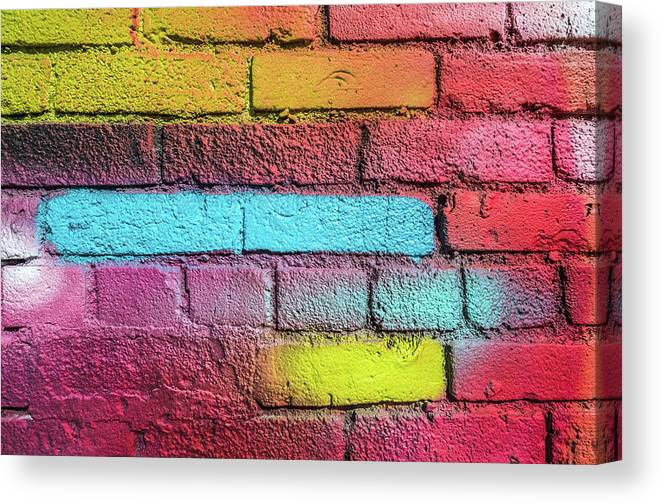 Photography Canvas Print featuring the photograph Multi-colored Brick Wall by Panoramic Images