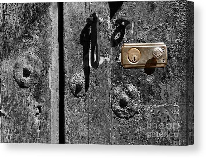 Still Life Canvas Print featuring the photograph New Lock On Old Door 2 by James Brunker