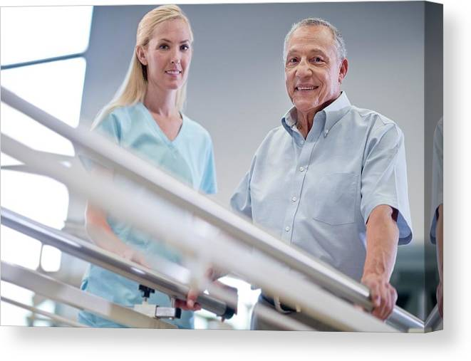 Indoors Canvas Print featuring the photograph Nurse With Senior Man Using Parallel Walking Bars by Science Photo Library