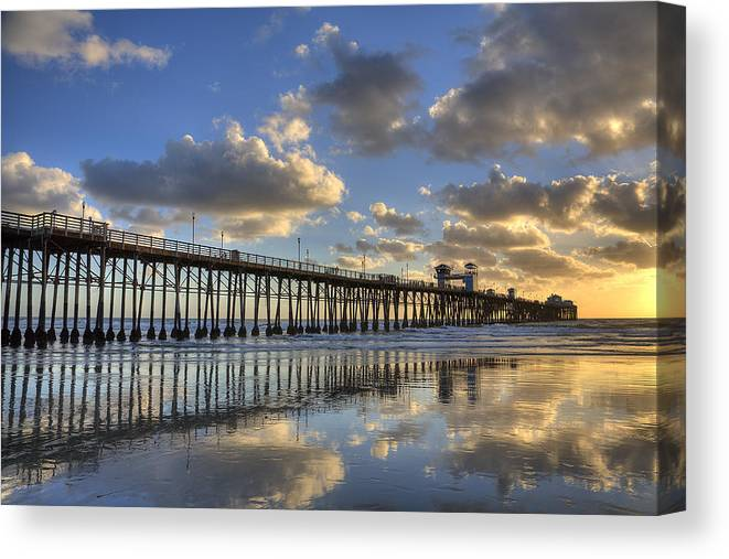 California Canvas Print featuring the photograph Oceanside Pier Sunset Reflection by Peter Tellone