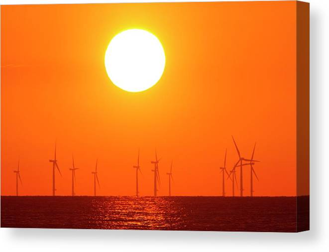 Sun Canvas Print featuring the photograph Offshore Wind Turbines At Sunset by David Woodfall Images/science Photo Library