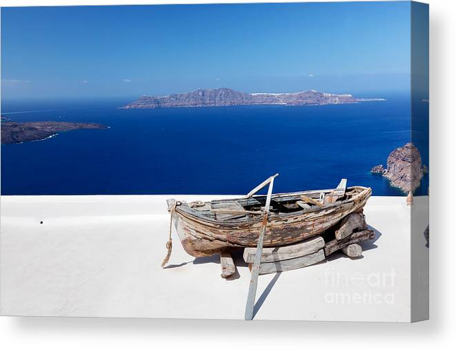 Santorini Canvas Print featuring the photograph Old Boat On The Roof Of The Building On Santorini Greece by Michal Bednarek