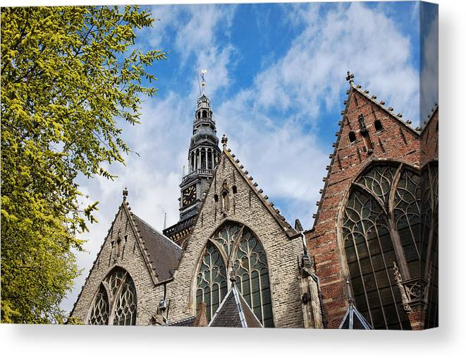 Amsterdam Canvas Print featuring the photograph Old Church In Amsterdam by Artur Bogacki