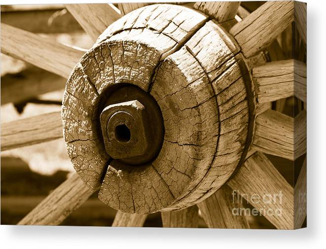 Wagon Canvas Print featuring the photograph Old Wagon Wheel - Sepia Rendering by Michael R Erwine