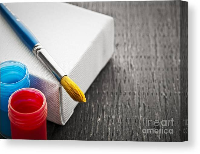 Brush Canvas Print featuring the photograph Paintbrush On Canvas by Elena Elisseeva