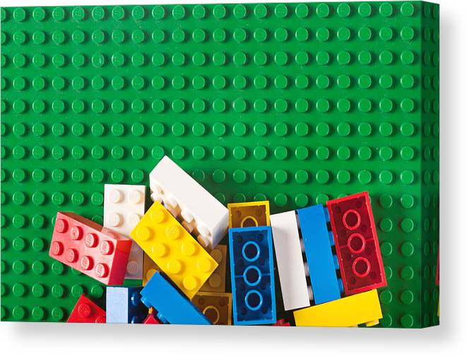 Pile Of Lego Blocks And Bricks On Green Baseplate Canvas Print