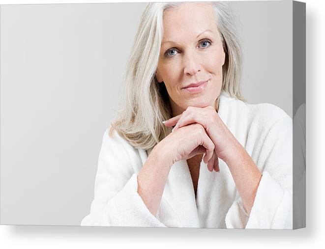 Mature Adult Canvas Print featuring the photograph Portrait Of Middle Aged Woman  Wearing Bathrobe by Image d107f9eca