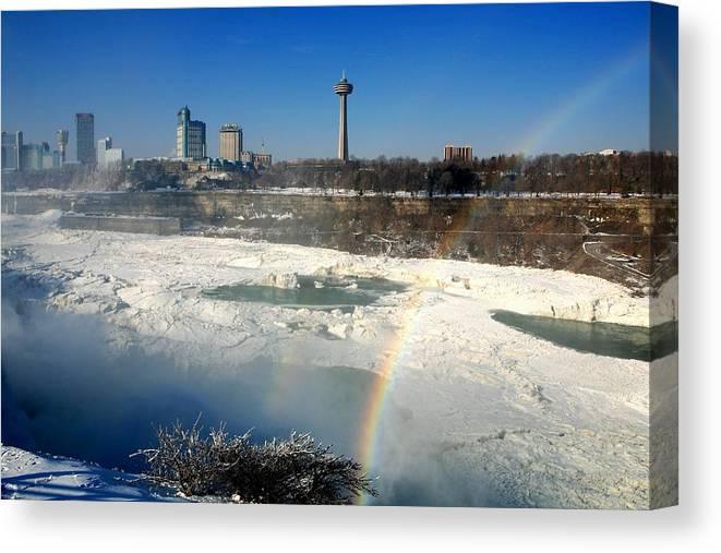 Niagara Falls Canvas Print featuring the photograph Rainbow Over Canada by Eric Swan
