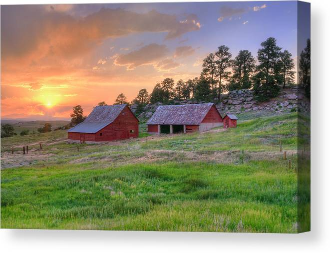 Colorado Barns Canvas Print featuring the photograph Red Barn At Sunset by Richard Raul Photography