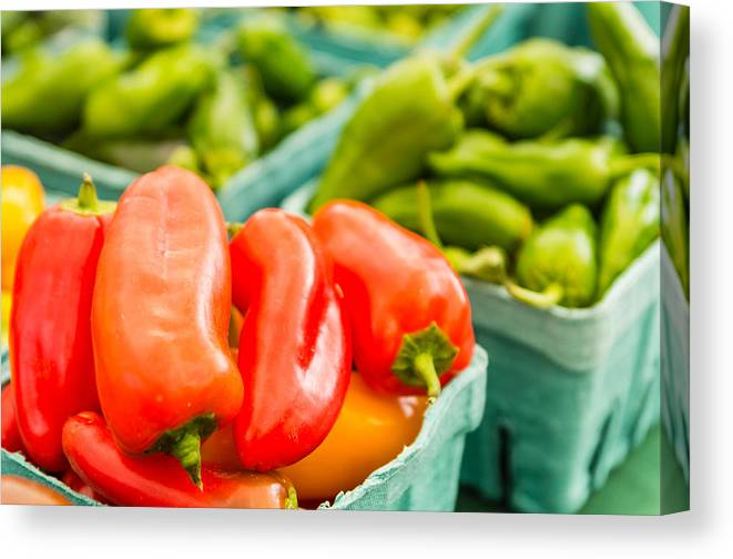 Agriculture Canvas Print featuring the photograph Red Peppers On Display by John Trax