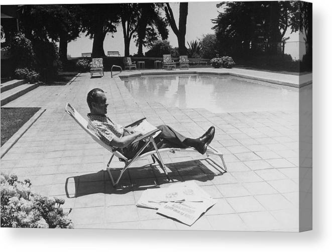 History Canvas Print featuring the photograph Richard Nixon Reading Newspapers While by Everett