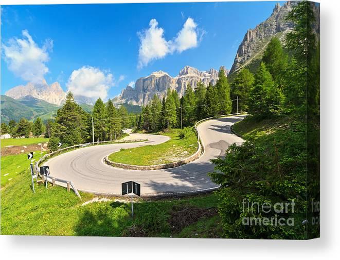 Alps Canvas Print featuring the photograph road to Pordoi pass by Antonio Scarpi