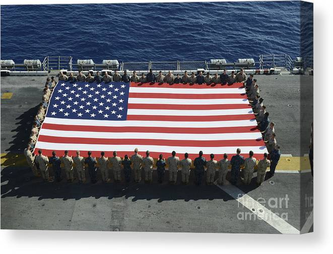 Horizontal Canvas Print featuring the photograph Sailors And Marines Display by Stocktrek Images