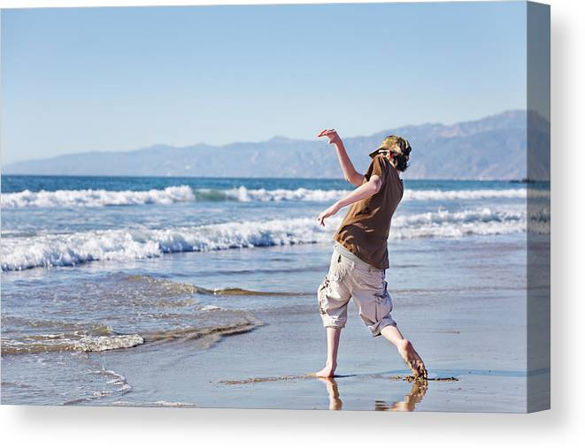 Teenage Boys Canvas Print featuring the photograph Skimming Stones by Jo Ann Snover