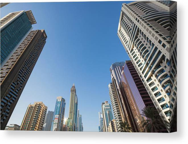 Photography Canvas Print featuring the photograph Skyscrapers Along Sheikh Zayed Road by Panoramic Images
