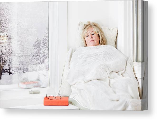 Lying On Back Canvas Print featuring the photograph Snuggling Under A Blanket by Jo Ann Snover