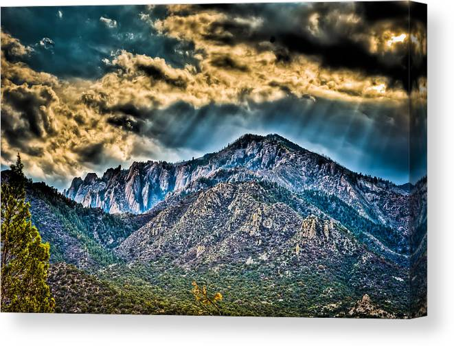 Mountains Canvas Print featuring the photograph Sunrays Over The Capitans by Helene Kobelnyk