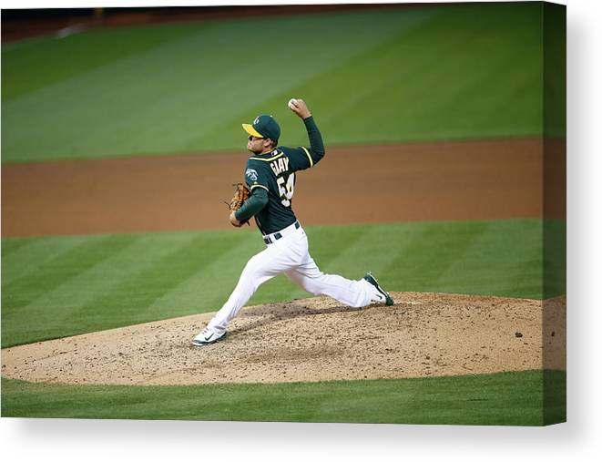 People Canvas Print featuring the photograph Tampa Bay Rays V Oakland Athletics by Michael Zagaris