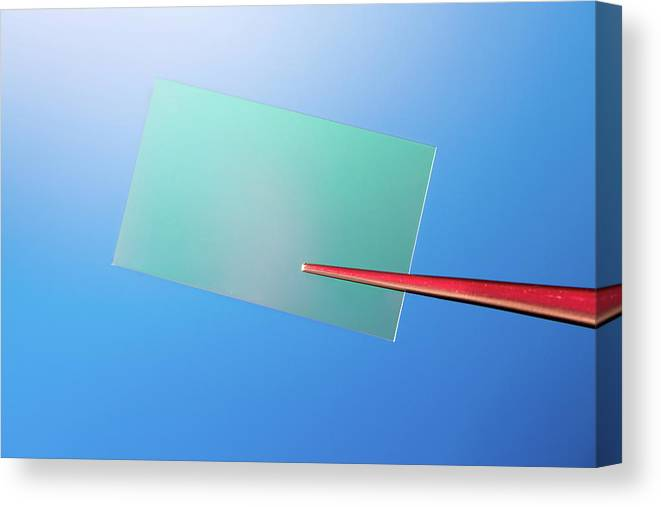 Nobody Canvas Print featuring the photograph Tweezers Holding A Piece Of Optical Glass by Wladimir Bulgar/science Photo Library