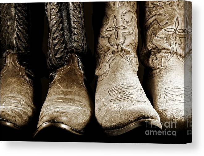 Cowboy Canvas Print featuring the photograph Two Pair Of Cowboy Boots Are Better Than One by Lincoln Rogers