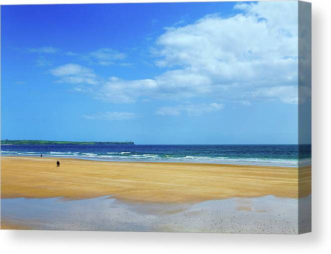 Photography Canvas Print featuring the photograph Walkers On The Strand In Tramore by Panoramic Images
