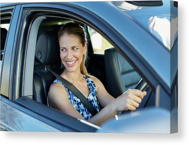 Transport Interior Canvas Print featuring the photograph Woman Looking Through Car Window by Science Photo Library