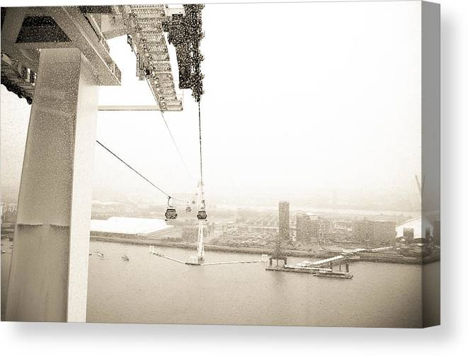 Air Line Canvas Print featuring the photograph Flight Over The Thames by Lenny Carter