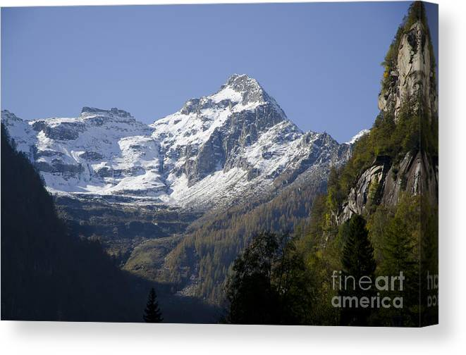 Mountain Canvas Print featuring the photograph Snow-capped Mountain by Mats Silvan