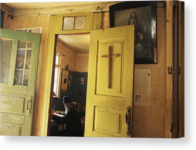 Commonwealth Of Independent States Canvas Print featuring the photograph A Clergyman Studies by Randy Olson