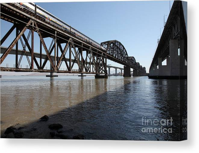 Transportation Canvas Print featuring the photograph Amtrak Train Riding Atop The Benicia-martinez Train Bridge In California - 5d18830 by Wingsdomain Art and Photography