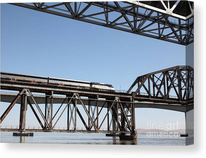 Transportation Canvas Print featuring the photograph Amtrak Train Riding Atop The Benicia-martinez Train Bridge In California - 5d18837 by Wingsdomain Art and Photography