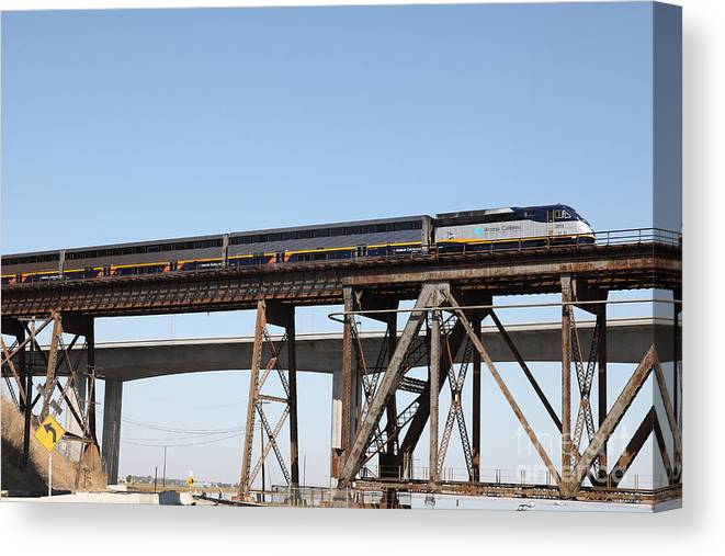 Transportation Canvas Print featuring the photograph Amtrak Train Riding Atop The Benicia-martinez Train Bridge In California - 5d18839 by Wingsdomain Art and Photography