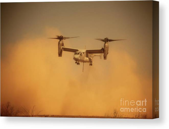 Dust Canvas Print featuring the photograph An Mv-22 Osprey Aircraft Blows Dust by Stocktrek Images