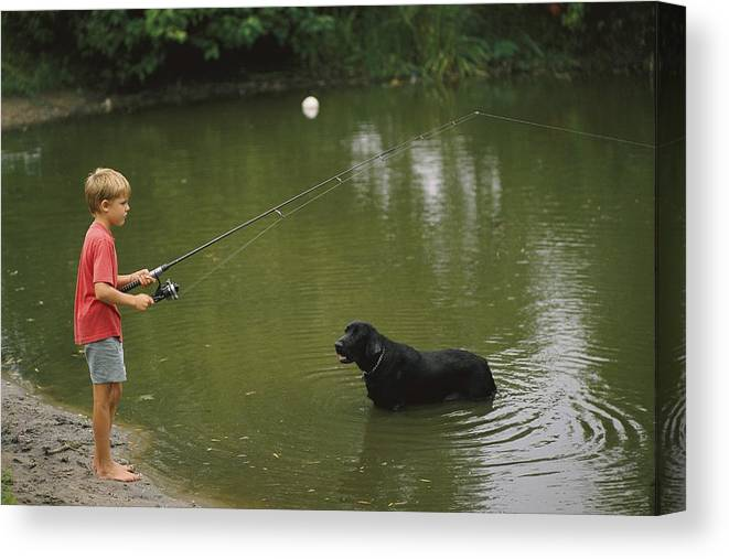 Boy Fishing In A Pond With A Black Canvas Print